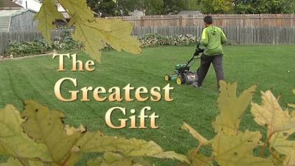 Brandon mowing lawn